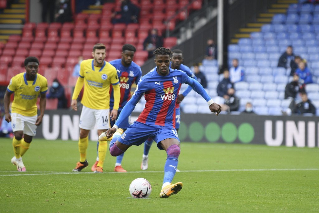 Crystal Palace's Wilfried Zaha scores scores his side's opening goal with a penalty kick during an English Premier League soccer match between Crystal...