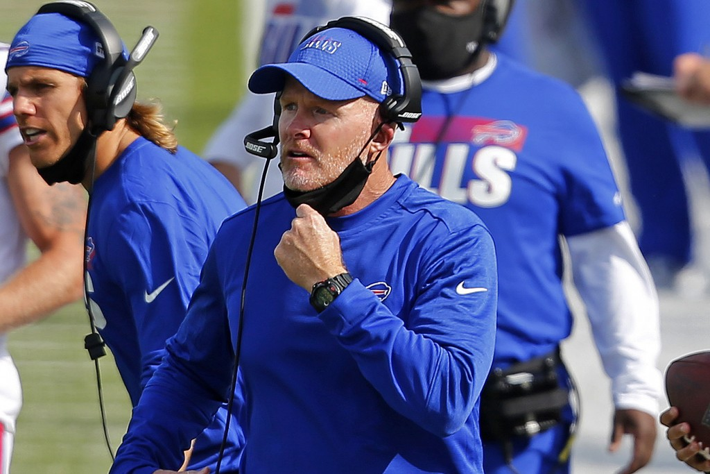 FILE - In this Sept. 13, 2020 file photo, Buffalo Bills head coach Sean McDermott pulls his mask down to give instructions on the sidelines during the...