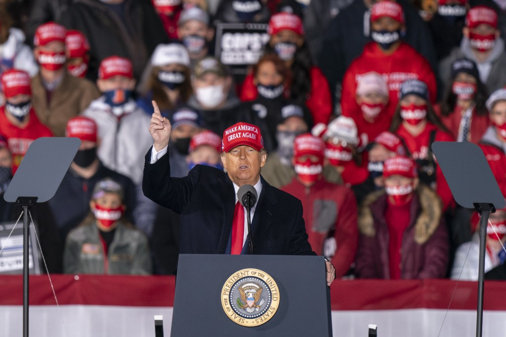 President Donald Trump speaks during a campaign rally at Southern Wisconsin Regional Airport, Saturday, Oct. 17, 2020, in Janesville, Wis. (AP Photo/A...