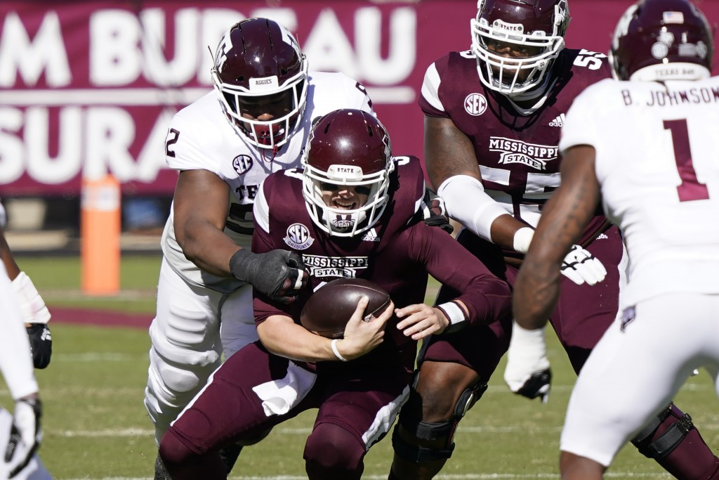 Mississippi State quarterback K.J. Costello (3) is sacked by a Texas A&M defender during the first half of an NCAA college football game in Starkville...
