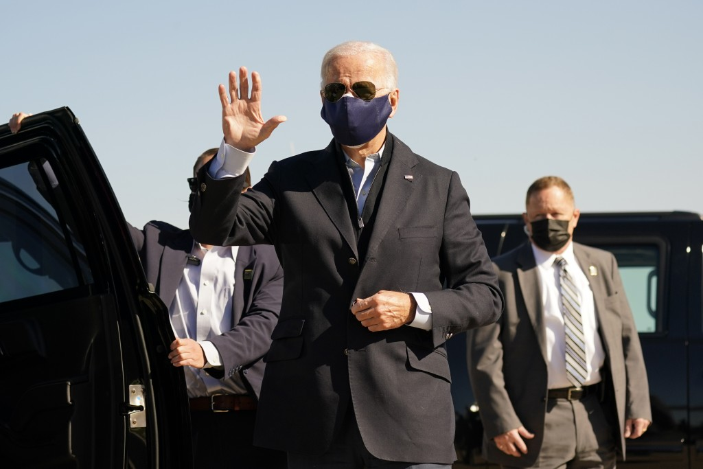Democratic presidential candidate former Vice President Joe Biden arrives to board his campaign plane at the New Castle Airport in New Castle, Del., S...