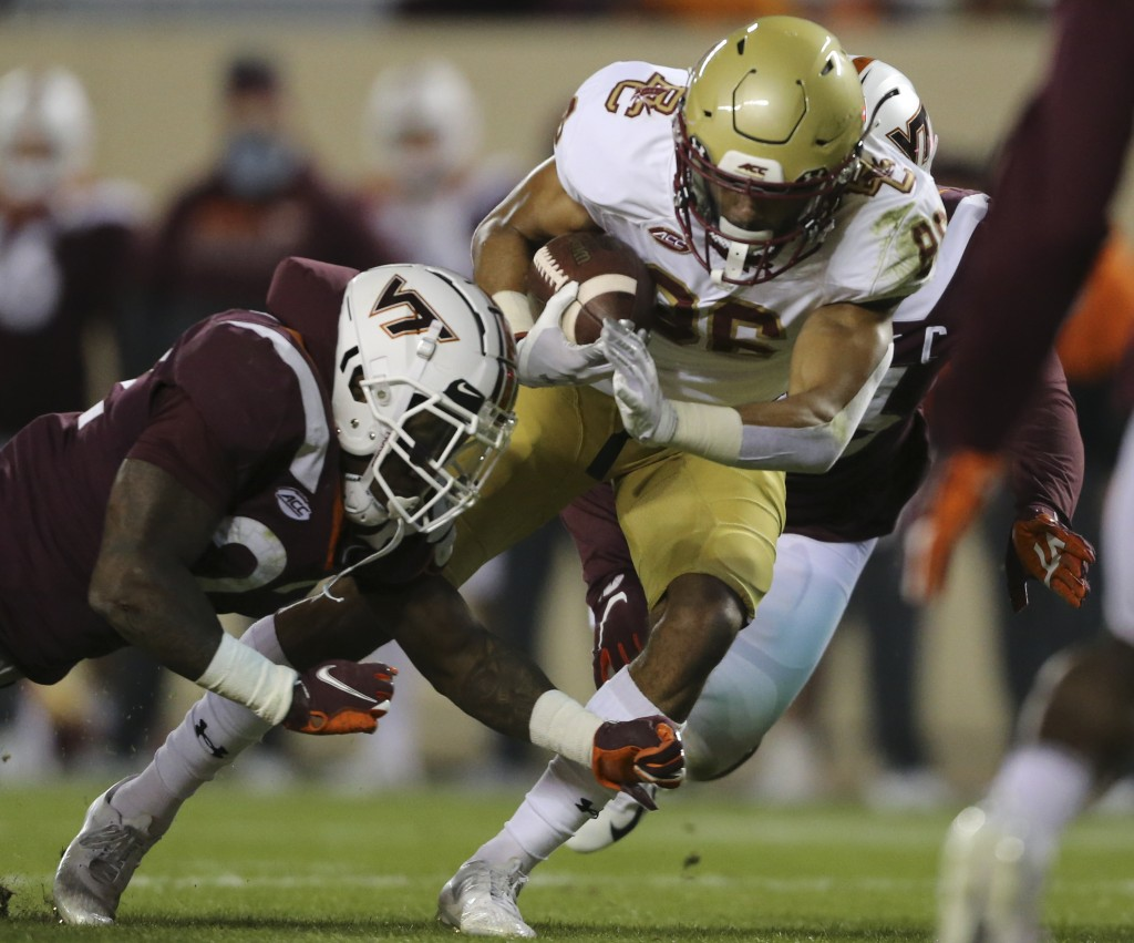 Jaelen Gill, right, of Boston College scores past Virginia Tech defenders Chamarri Conner, left, first half of an NCAA college football game in Blacks...