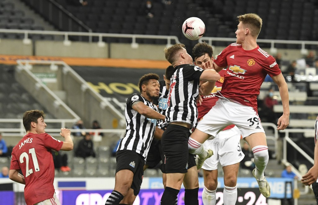 Manchester United's Harry Maguire, second right, scores their first goal during the English Premier League soccer match between Newcastle United and M...