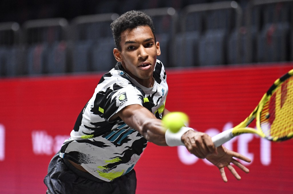 Canada's Felix Auger-Aliassime returns the ball during the ATP bett1HULKS Indoors tennis final against Germany's Alexander Zverev in Cologne, Germany,...