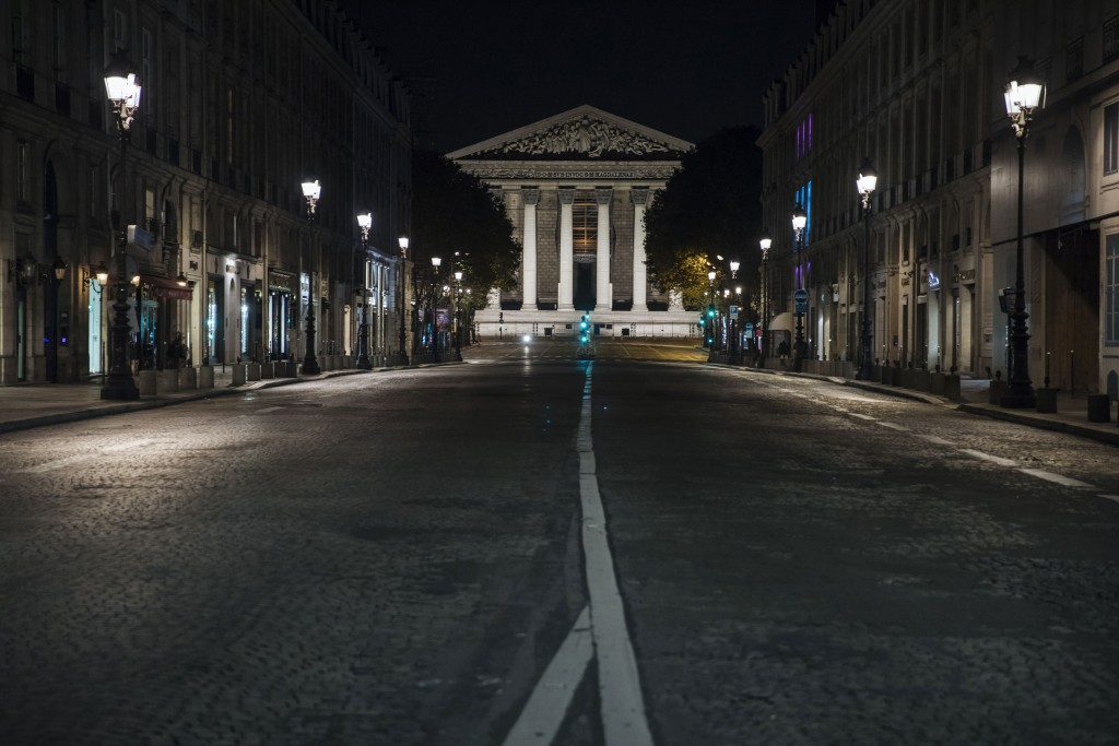 Madeleine square is empty during curfew in Paris, Saturday, Oct. 17, 2020. French restaurants, cinemas and theaters are trying to figure out how to su...