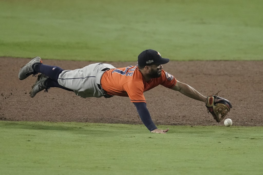 Houston Astros second baseman Jose Altuve misses a single by Tampa Bay Rays' Ji-Man Choi during the sixth inning in Game 7 of a baseball American Leag...