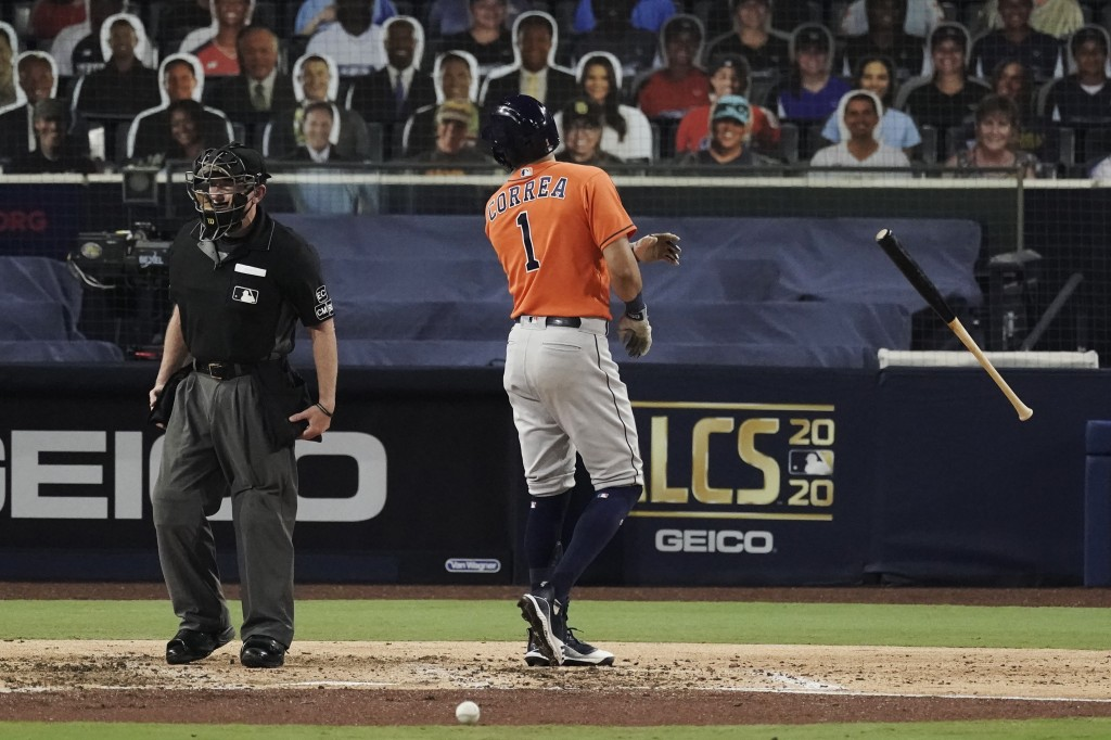 Houston Astros Carlos Correa tosses his bat and has words with home plate umpire Lance Barksdale after striking out during the fourth inning in Game 7...