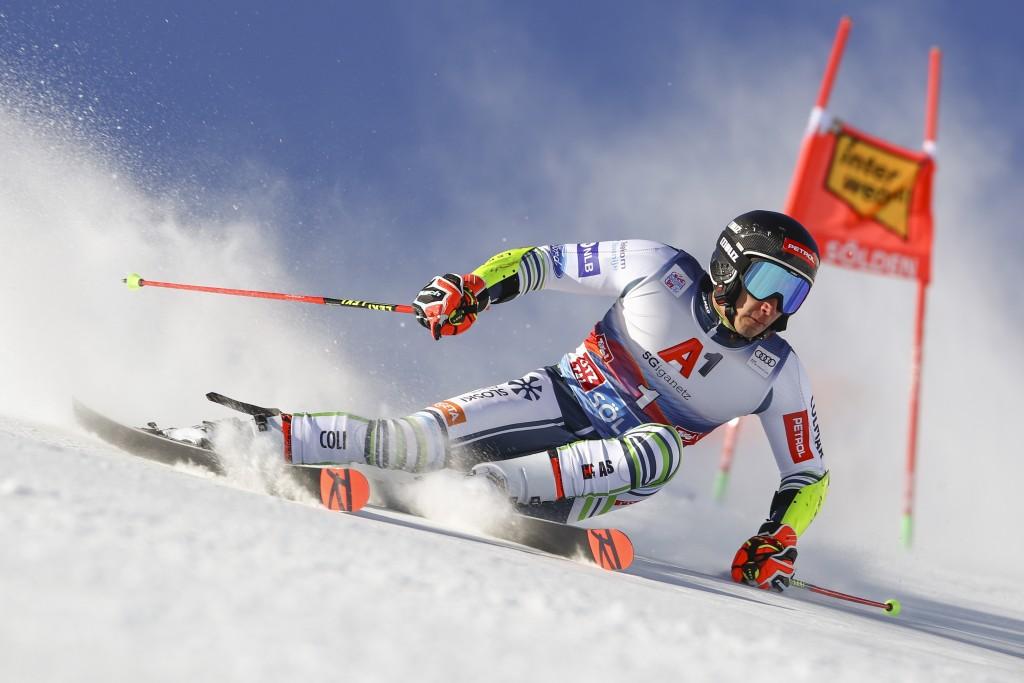 Slovenia's Zan Kranjec speeds down the course during an alpine ski, men's World Cup giant slalom in Soelden, Austria, Sunday, Oct. 18, 2020. (AP Photo...