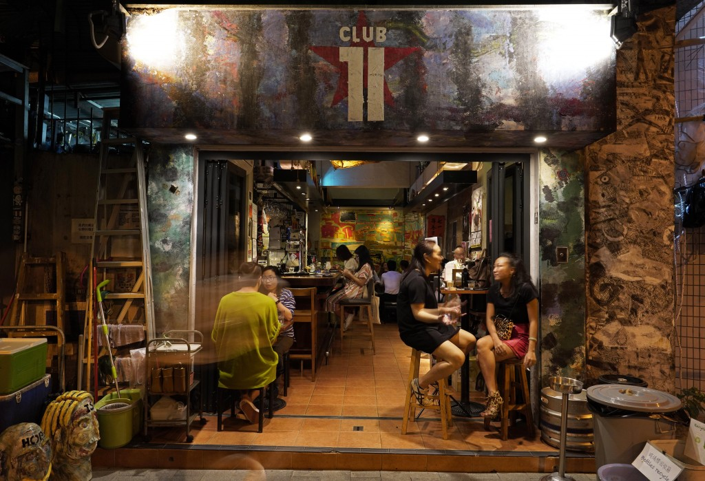 In this Oct. 7, 2020, photo, customers sit at Club 71 in Hong Kong. The bar known as a gathering place for pro-democracy activists and intellectuals i...
