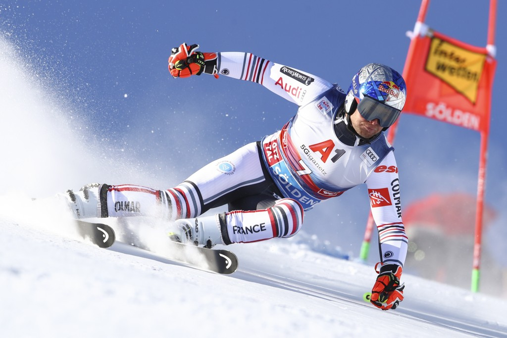 France's Alexis Pinturault speeds down the course during an alpine ski, men's World Cup giant slalom in Soelden, Austria, Sunday, Oct. 18, 2020. (AP P...