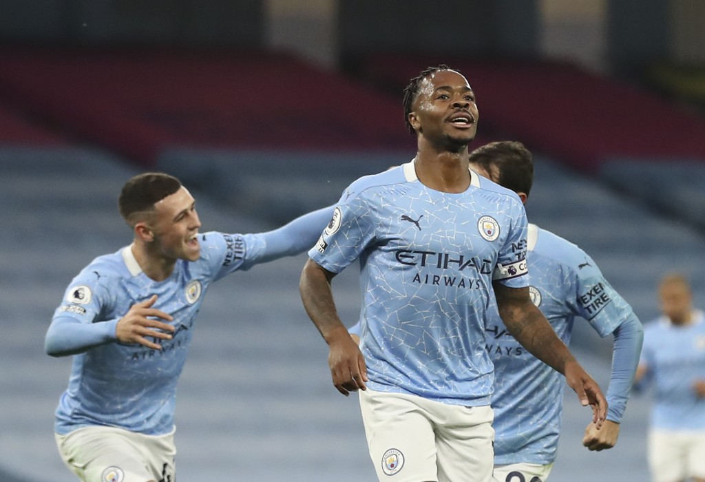 Manchester City's Raheem Sterling, front, celebrates after scoring his side's opening goal during the English Premier League soccer match between Manc...
