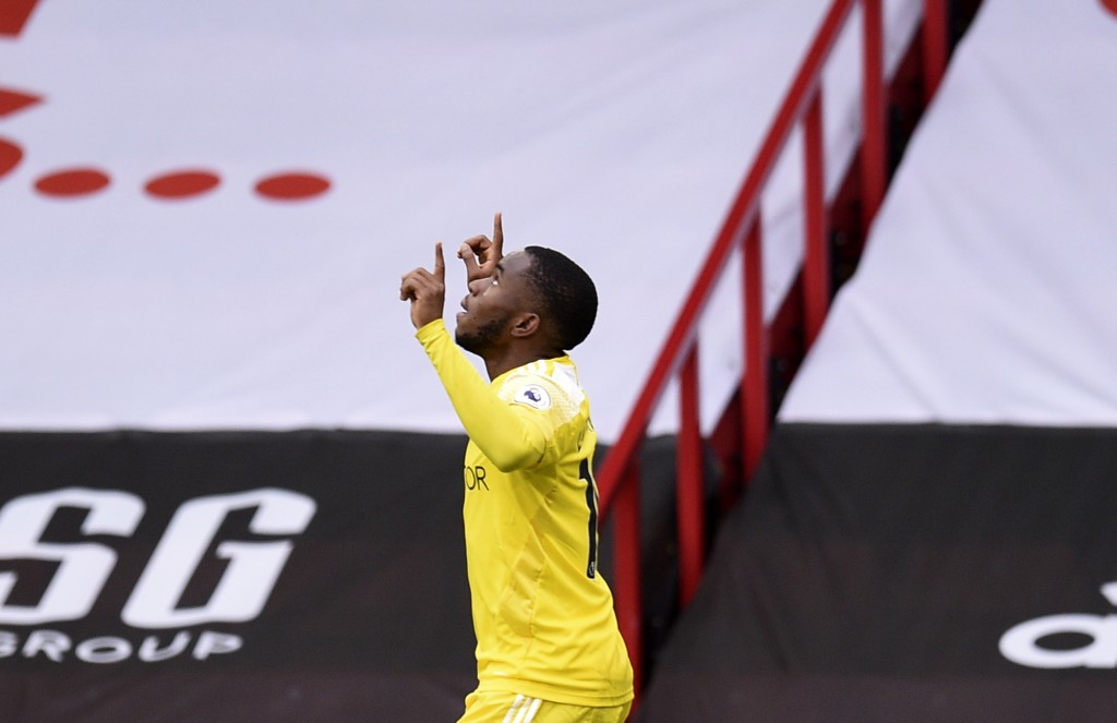 Fulham's Ademola Lookman celebrates after scoring his side's opening goal during the English Premier League soccer match between Sheffield United and ...