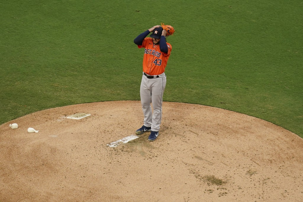 Houstnn Astros starting pitcher Lance McCullers Jr. adjusts his cap during the second inning in Game 7 of a baseball American League Championship Seri...