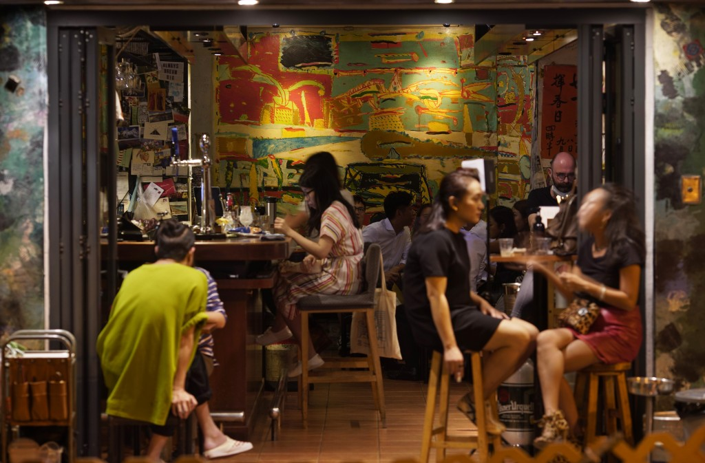 In this Oct. 7, 2020 photo, customers sit at Club 71 in Hong Kong. The bar known as a gathering place for pro-democracy activists and intellectuals is...