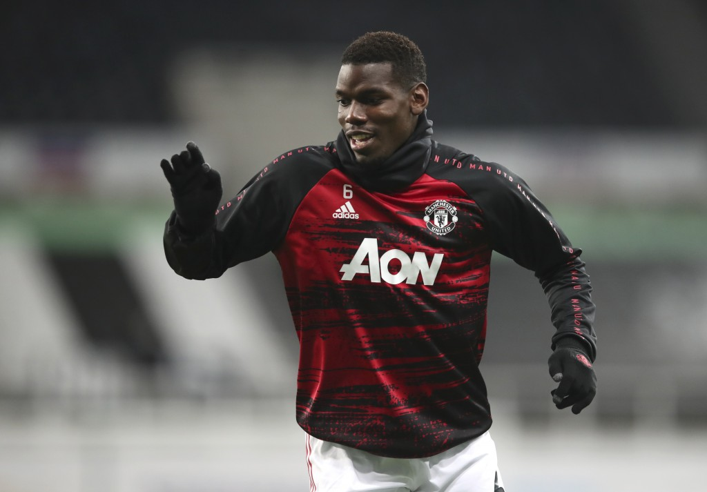 Manchester United's Paul Pogba warms up prior to the English Premier League soccer match between Newcastle United and Manchester United at St. James' ...