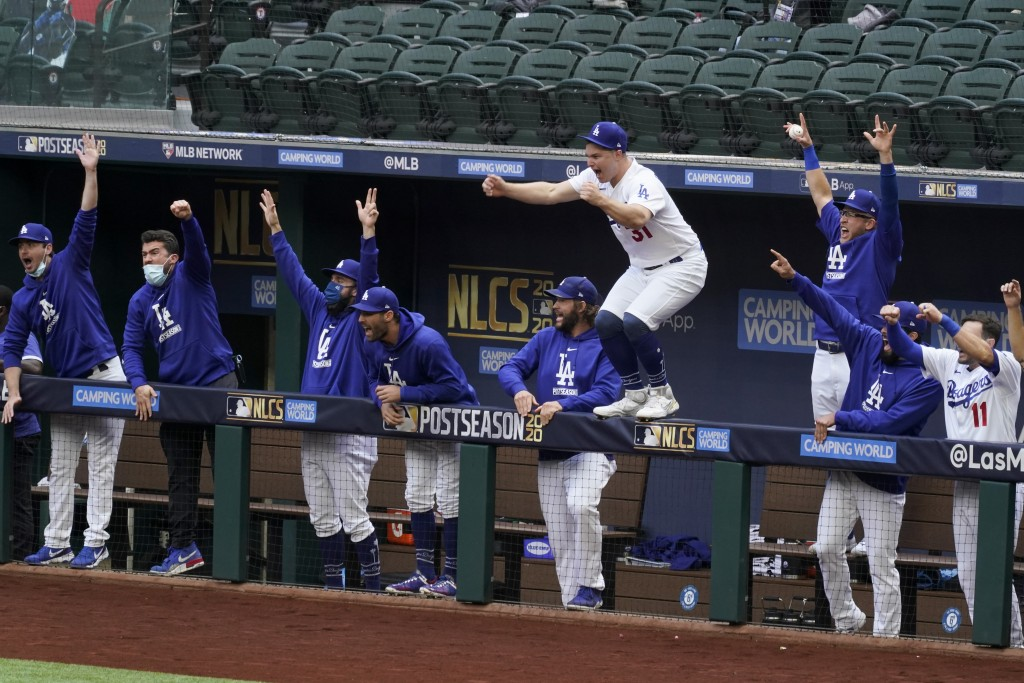 Los Angeles Dodgers celebrate a home run by Justin Turner during the first inning in Game 6 of a baseball National League Championship Series against ...