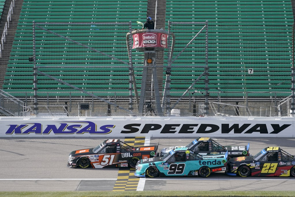 Chandler Smith (51) takes the green flag with Ben Rhodes (99), Sheldon Creed (2) and Brett Moffitt (23) during a NASCAR Truck Series auto race at Kans...