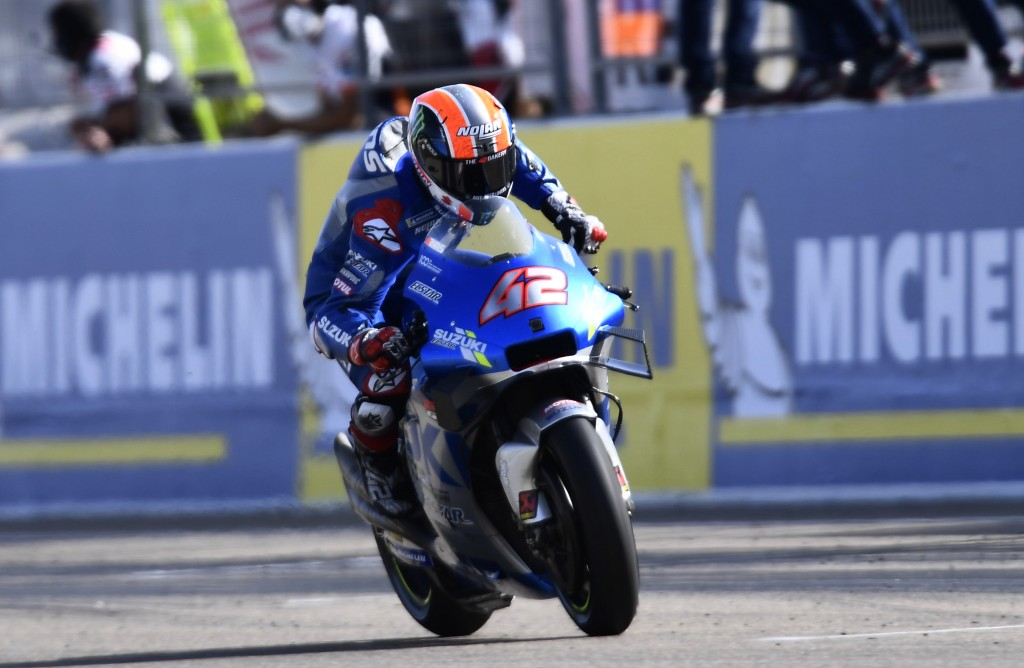 Suzuki rider Alex Rins, of Spain, celebrates as he crosse the finish line after winning the Aragon Motorcycle Grand Prix at the Motorland circuit in A...