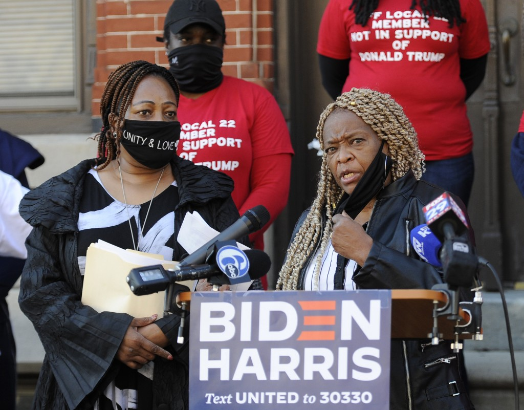 Crystal Williams-Coleman, President the Guardian Civic League, right, talks to reporters during a press conference, Friday, Oct. 9, 2020, in Philadelp...