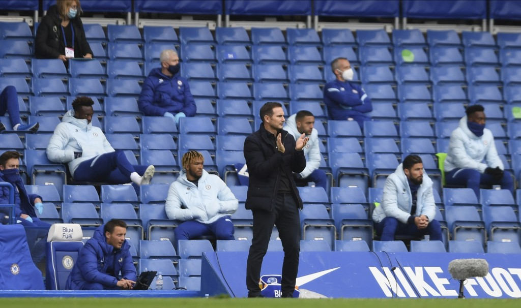 Chelsea's head coach Frank Lampard, center, reacts during the English Premier League soccer match between Southampton and Chelsea at the Stamford Brid...