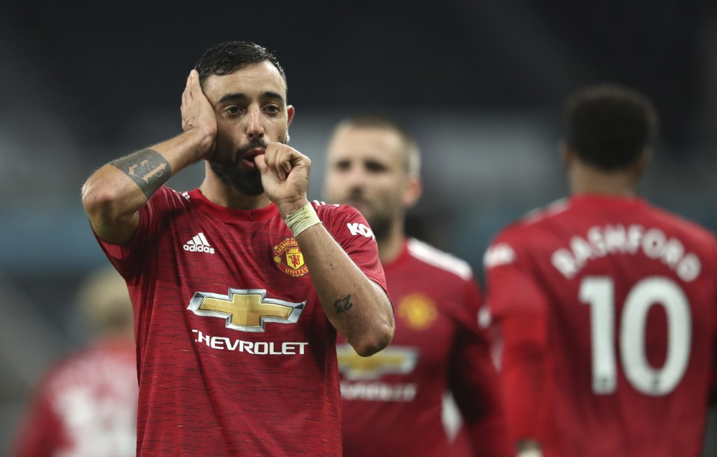 Manchester United's Bruno Fernandes celebrates after scoring the 2-1 lead during the English Premier League soccer match between Newcastle United and ...