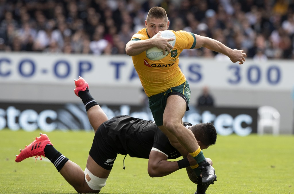 Australia's James O'Connor is tackled by New Zealand's Tupou Vaa'i during the second Bledisloe Rugby test between the All Blacks and the Wallabies at ...