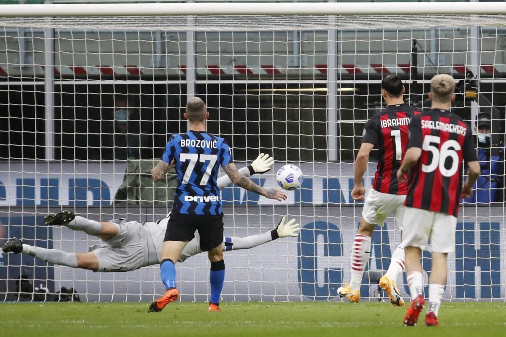 AC Milan's Zlatan Ibrahimovic scores his side's second goal during the Serie A soccer match between Inter Milan and AC Milan at the San Siro Stadium, ...