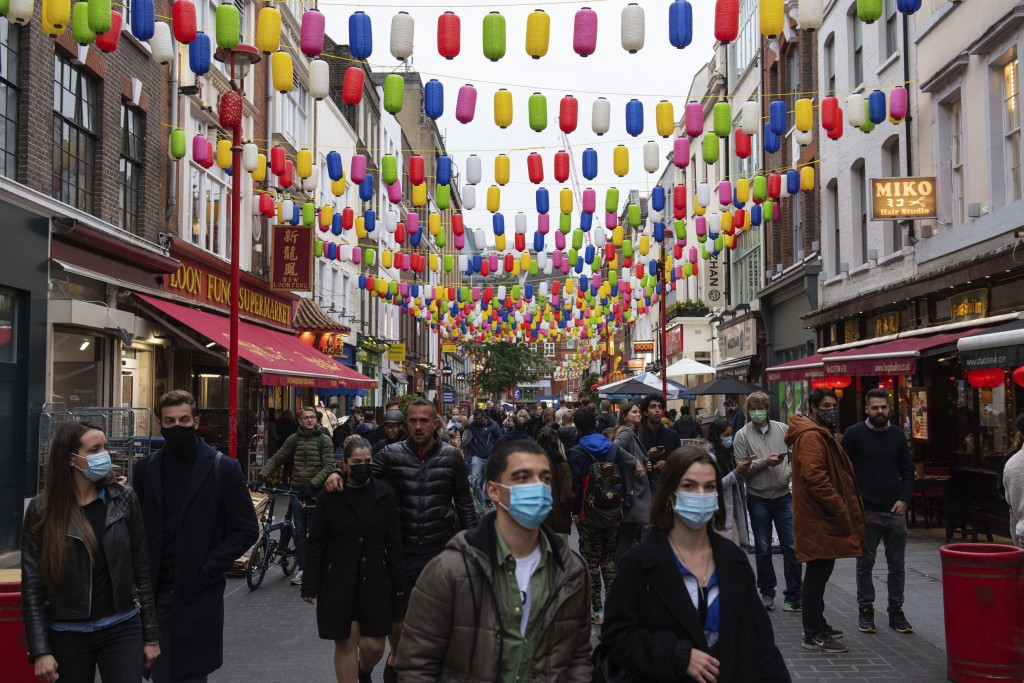 People out in Chinatown, on the first day after the city was put into Tier 2 restrictions to curb the spread of coronavirus, in London, Saturday, Oct....