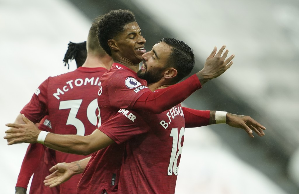 Manchester United's Marcus Rashford, centre, celebrates his goal during the English Premier League soccer match between Newcastle United and Mancheste...
