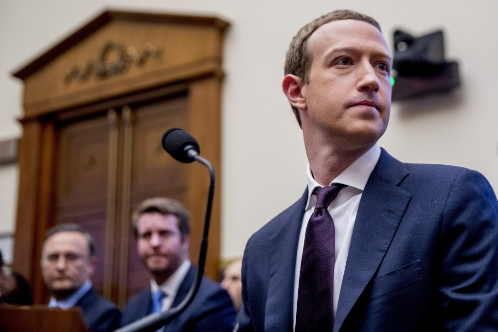 FILE - In this Wednesday, Oct. 23, 2019, file photo, Facebook CEO Mark Zuckerberg arrives for a House Financial Services Committee hearing on Capitol ...