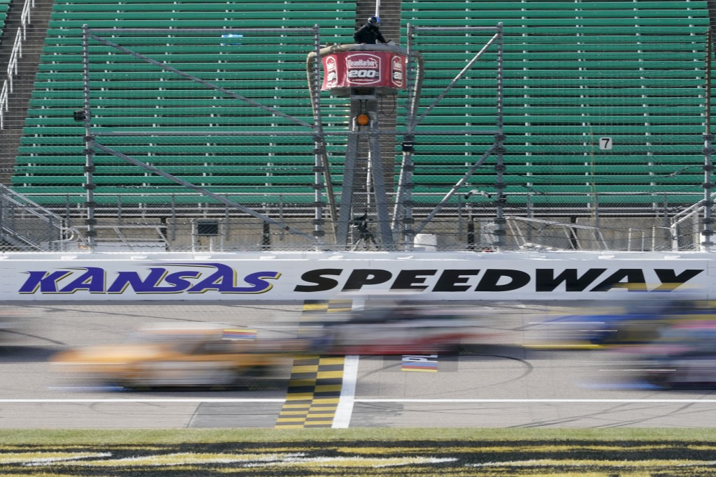 Drivers take the green flag during a NASCAR Truck Series auto race at Kansas Speedway in Kansas City, Kan., Saturday, Oct. 17, 2020. (AP Photo/Orlin W...