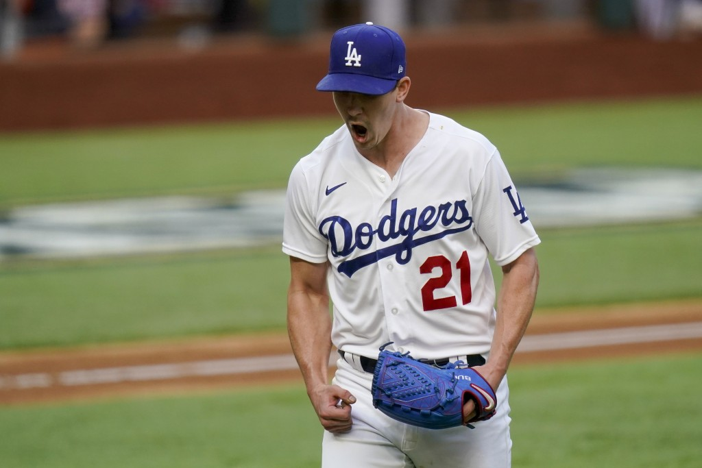 Los Angeles Dodgers starting pitcher Walker Buehler celebrates after striking out Atlanta Braves' Austin Riley during the sixth inning in Game 6 of a ...