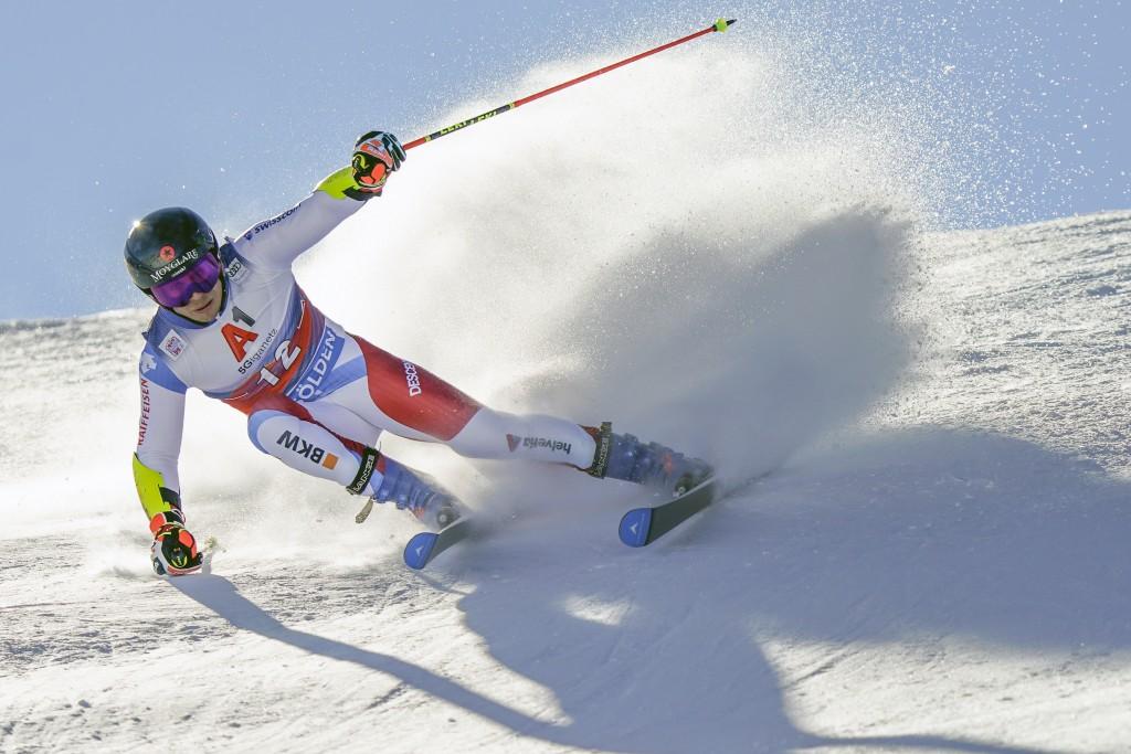 Switzerland's Gino Caviezel speeds down the course during an alpine ski, men's World Cup giant slalom in Soelden, Austria, Sunday, Oct. 18, 2020. (AP ...