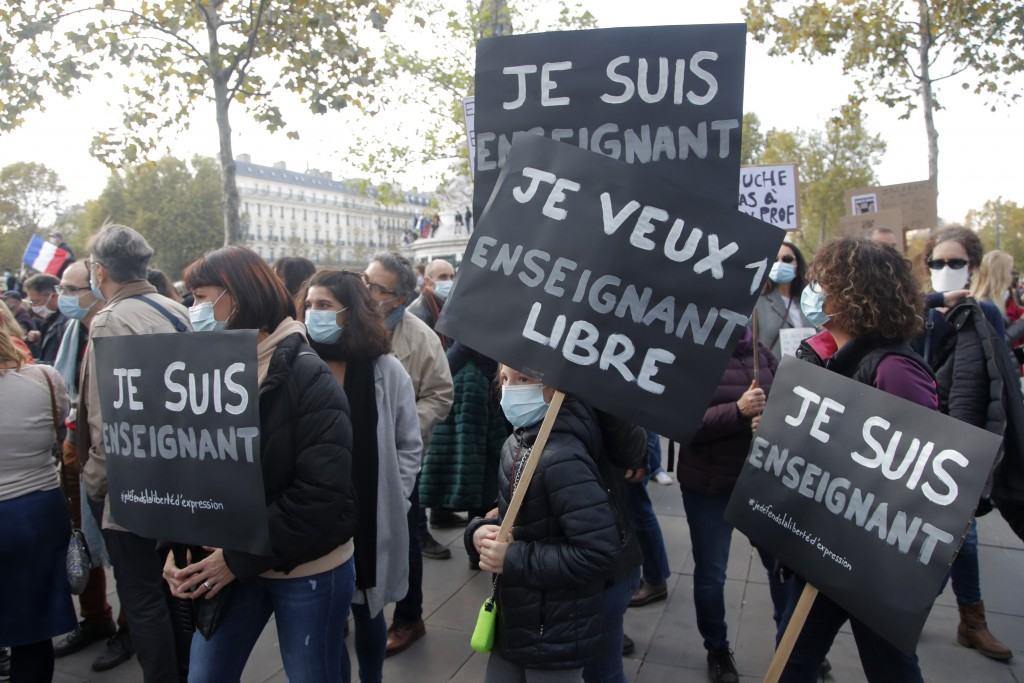 """Demonstrators hold placards reading """"I am a teacher"""" during a demonstration Sunday Oct. 18, 2020 in Paris. Demonstrations around France have been call..."""