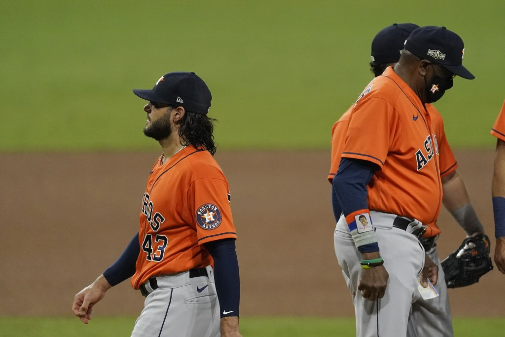 Houston Astros pitcher Lance McCullers Jr. walks off the field after being pulled from the game by Houston Astros manager Dusty Baker Jr. during the f...