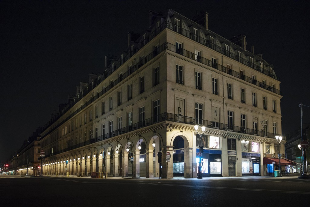 Rivoli street is empty during curfew in Paris, Saturday, Oct. 17, 2020. French restaurants, cinemas and theaters are trying to figure out how to survi...