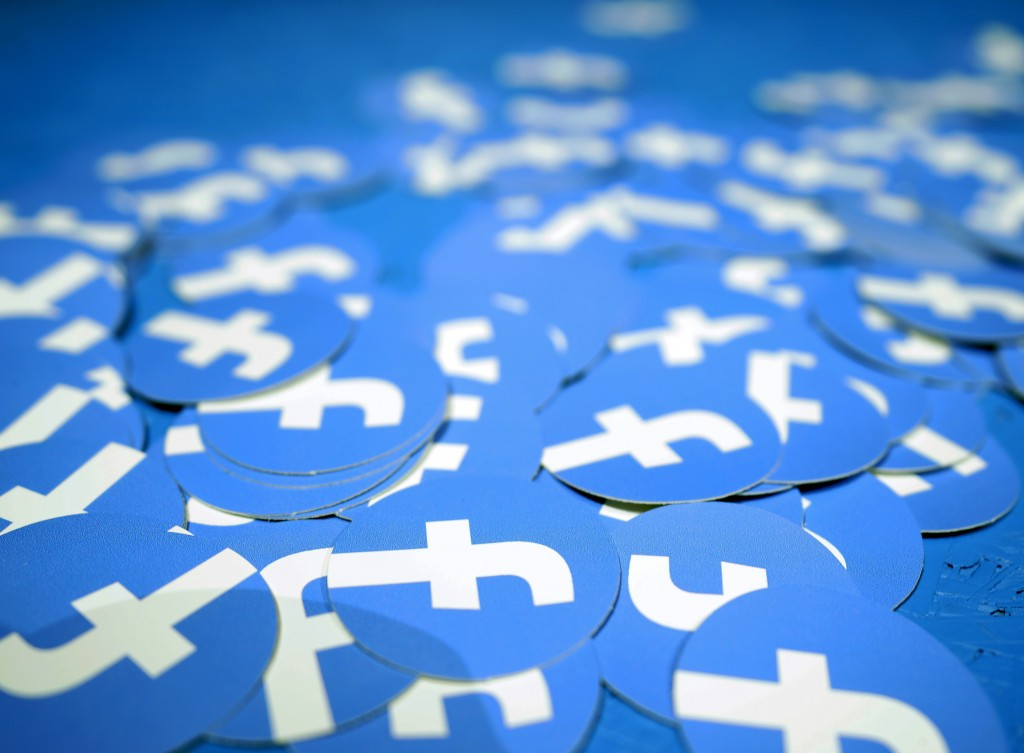 FILE - In this April 30, 2019, file photo, Facebook stickers are laid out on a table at F8, Facebook's developer conference in San Jose, Calif. Ever s...