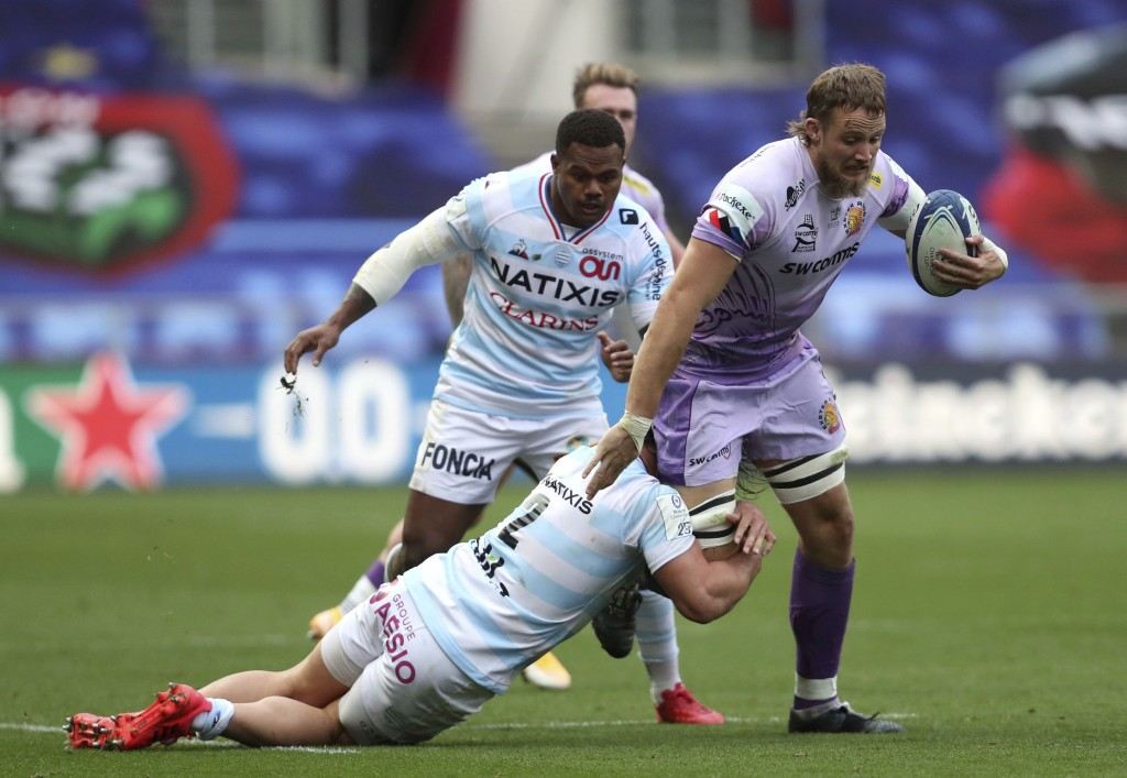 Exeter Chiefs' Jonny Hill is tackled by Racing 92's Camille Chat, during the European Champions Cup Final rugby match between Exeter Cheifs and Racing...