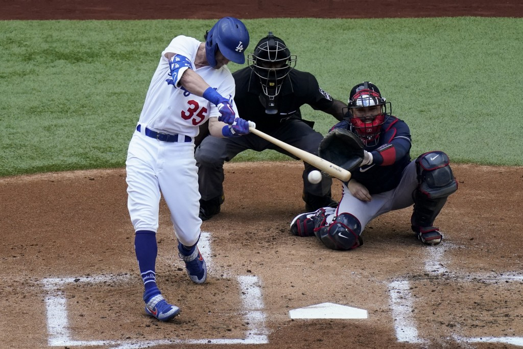 Los Angeles Dodgers' Cody Bellinger hits a RBI-single against the Atlanta Braves during the first inning in Game 6 of a baseball National League Champ...