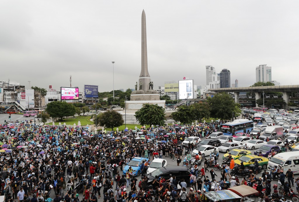 Pro-democracy protesters gather at Victory Monument in Bangkok, Thailand, Sunday, Oct. 18, 2020. Thai police on Sunday declined to say whether they we...