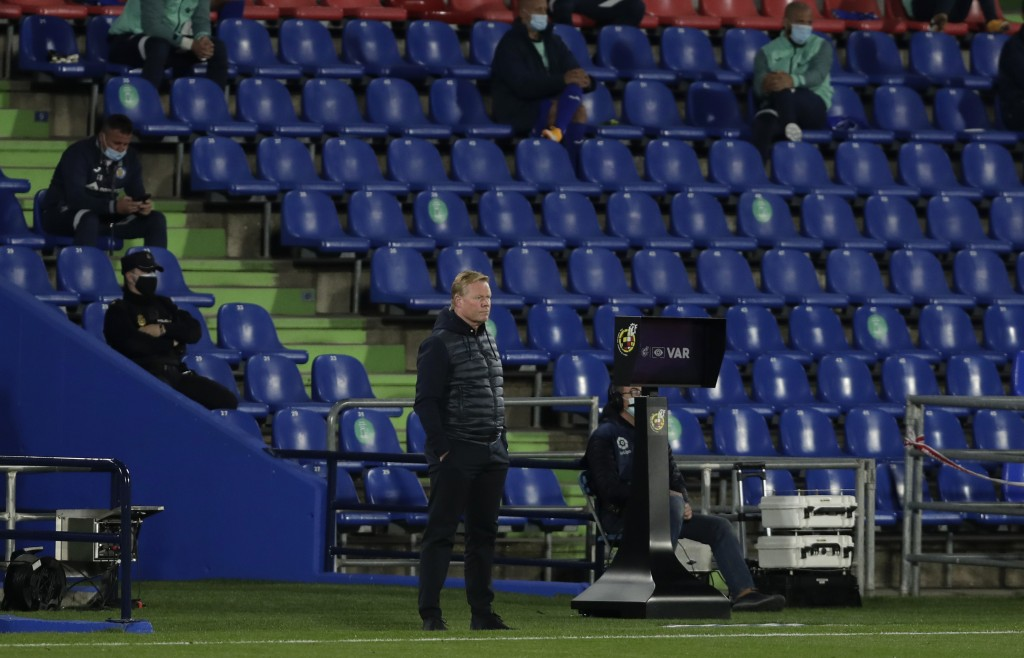 Barcelona's head coach Ronald Koeman watches the game during the Spanish La Liga soccer match between Getafe and FC Barcelona at the Alfonso Perez sta...