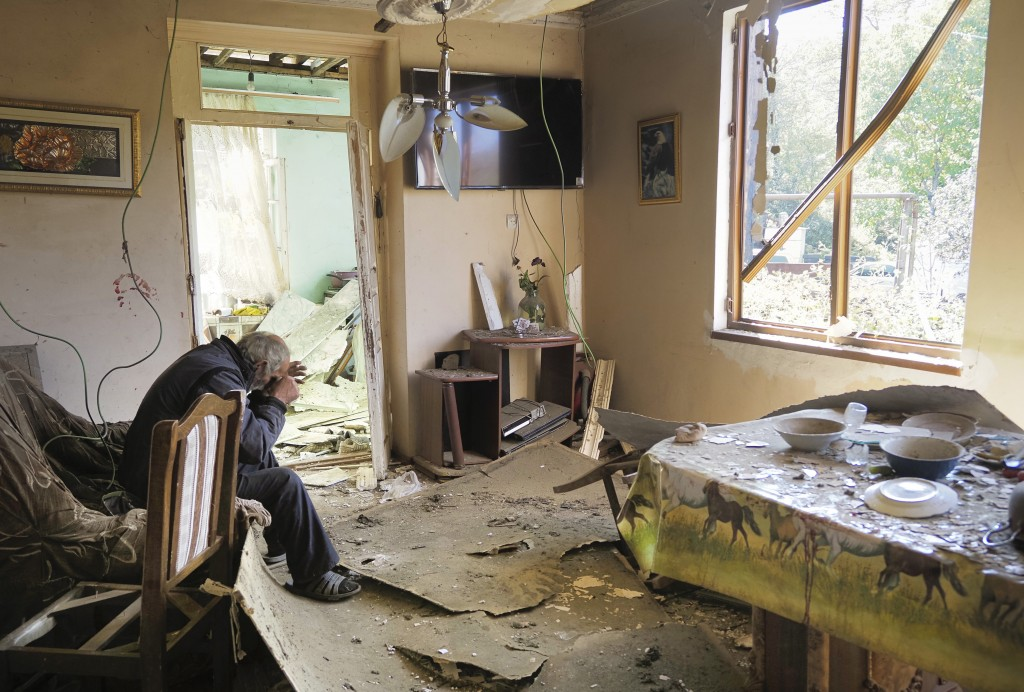 Yury Melkonyan, 64, sits in his house damaged by shelling from Azerbaijan's artillery during a military conflict in Shosh village outside Stepanakert,...