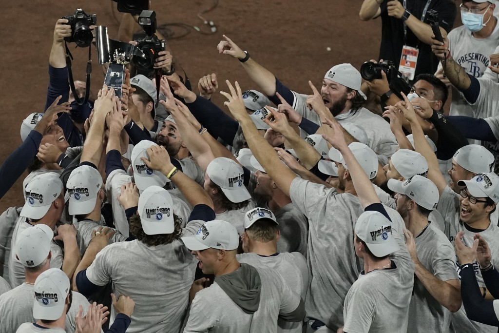 Tampa Bay Rays hold the American League championship trophy following their victory against the Houston Astros in Game 7 of a baseball American League...