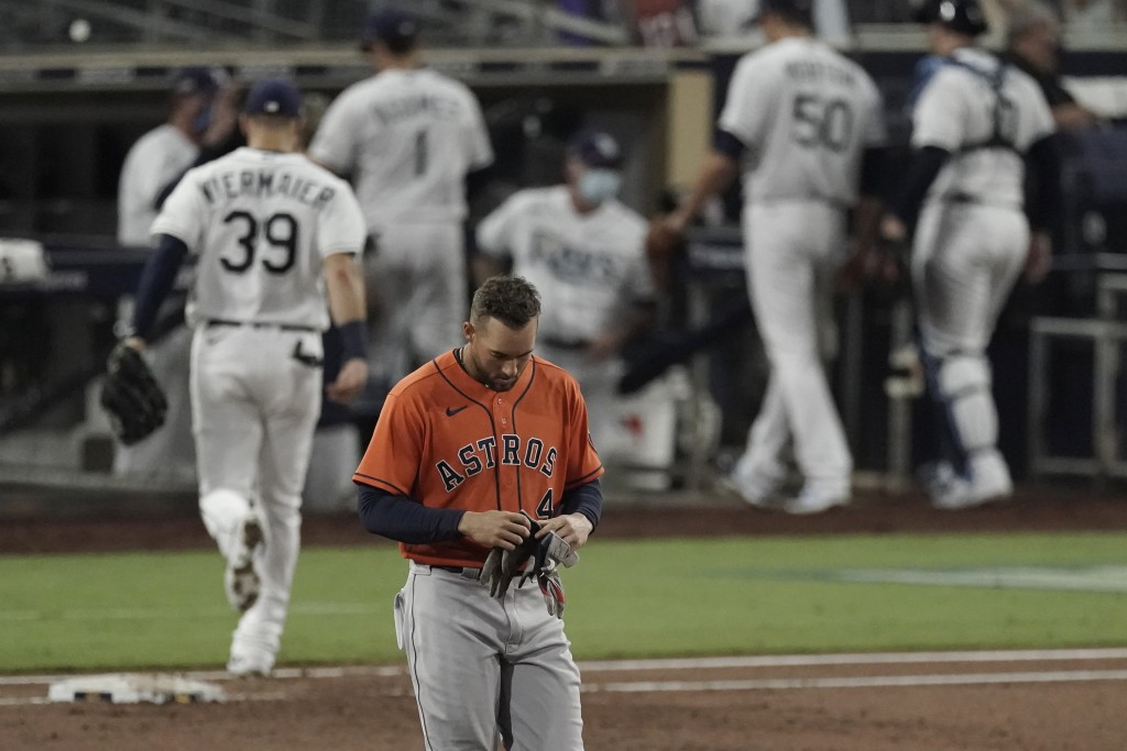 Houston Astros George Springer walks back to the dugout after grounding out against the Tampa Bay Rays during the third inning in Game 7 of a baseball...
