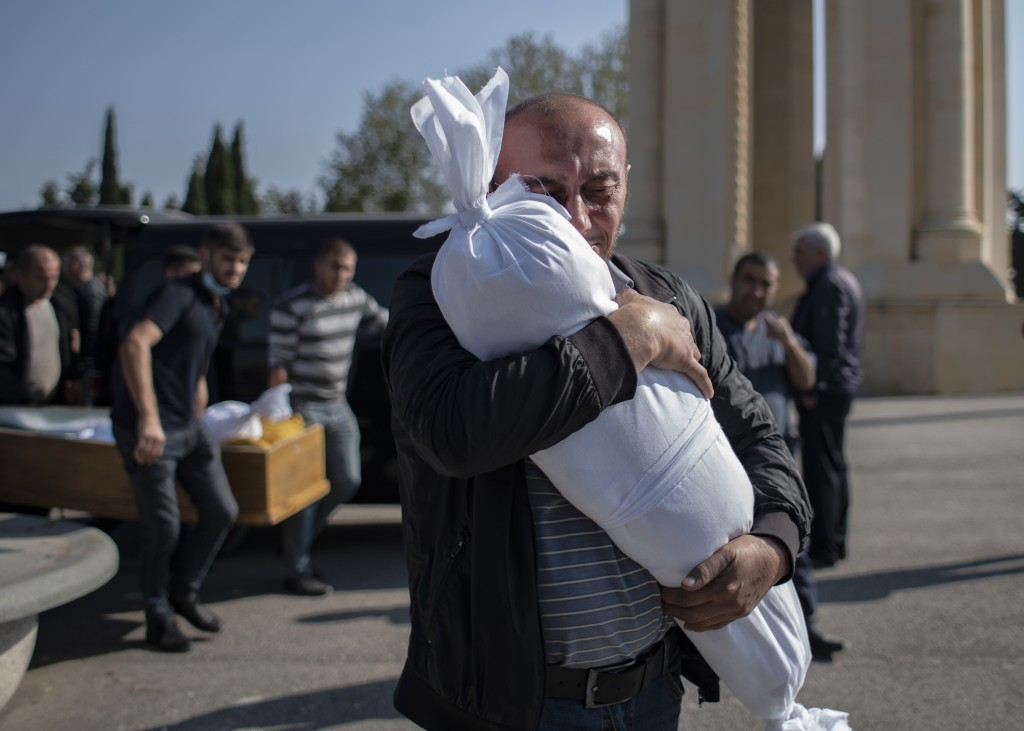 Timur Haligov, an Azerbaijani Turkish father embraces the body of his 10-month-old baby girl, Narin, who was killed by overnight shelling by Armenian ...