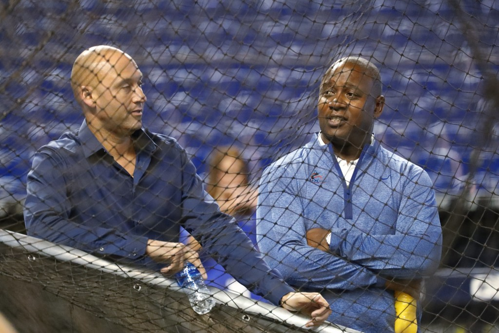 FILE - In this Wednesday, Aug. 28, 2019, file photo, Miami Marlins CEO Derek Jeter, left, and Michael Hill, President of Baseball Operations, watch ba...
