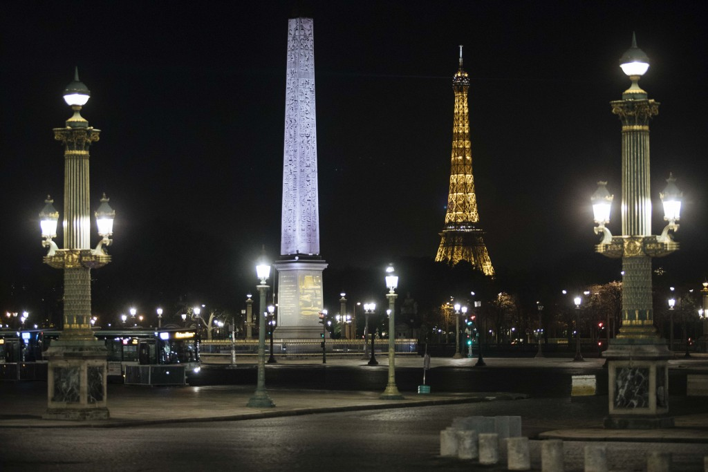 Concorde square is empty during curfew in Paris, Saturday, Oct. 17, 2020. French restaurants, cinemas and theaters are trying to figure out how to sur...