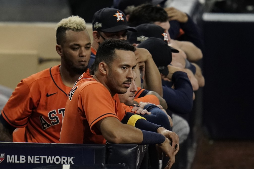 Houston Astros Carlos Correa watches the eighth inning from the dugout in Game 7 of a baseball American League Championship Series, Saturday, Oct. 17,...