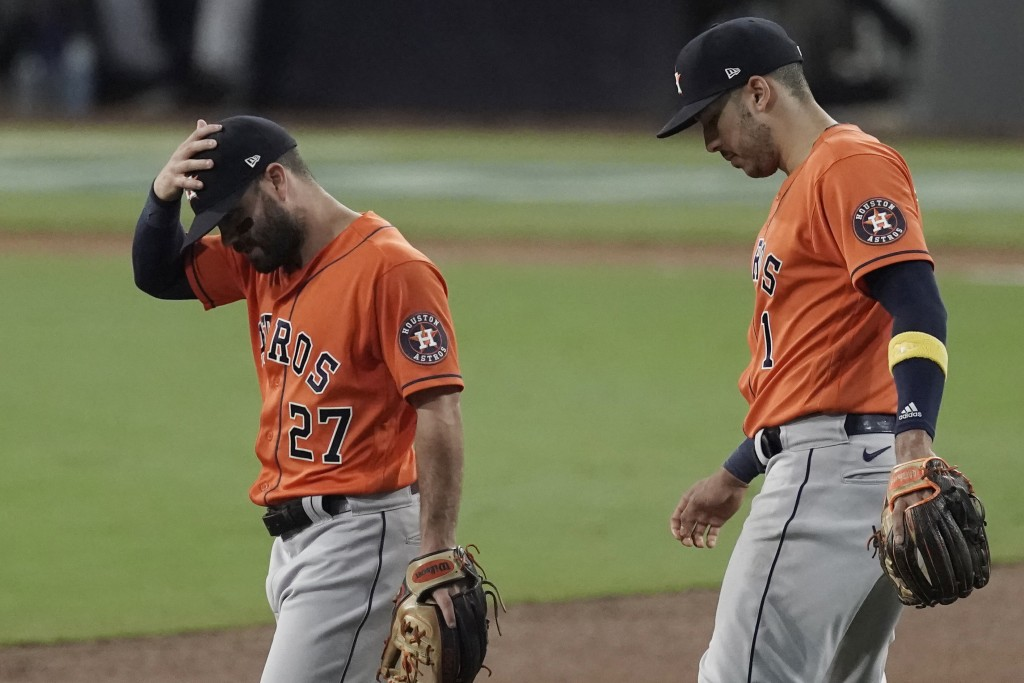 Houston Astros second baseman Jose Altuve (27) and Carlos Correa react after Tampa Bay Rays' Mike Zunino's home run during the second inning in Game 7...