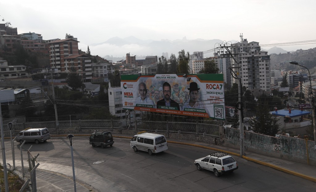 A billboard promotes presidential candidate Carlos Mesa of the Citizen Community political party, in La Paz, Bolivia, Saturday, Oct. 17, 2020. Sunday'...